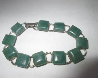 Beautiful vintage light green  stone bracelet use coupon code GOTTOGO for 30% off