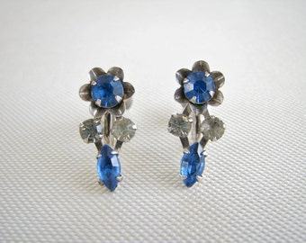 Vintage silver tone B. N. screw back floral earrings with royal blue and clear rhinestones