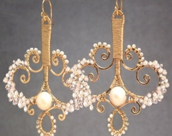 Hammered swirled shapes wrapped with pearls Cosmopolitan 112