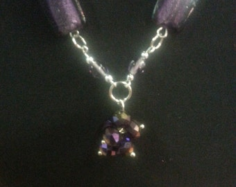 purple and silver tone necklace