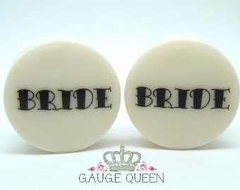 "Bride Plugs / Gauges. 4g / 5mm, 2g / 6.5mm, 0g / 8mm, 00g / 10mm, 1/2"" / 12.5mm, 9/16"" / 14mm, 5/8"" / 16mm, 3/4"" /19mm, 7/8"" /22mm, 1"" /25mm"