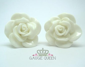 "White Rose Plugs / Gauges. 4g / 5mm, 2g / 6.5mm, 0g / 8mm, 00g / 10mm, 1/2"" / 12mm, 9/16"" / 14mm"