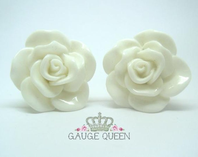 "White Rose Plugs / Gauges. 4g / 5mm, 2g / 6.5mm, 0g / 8mm, 00g / 10mm, 1/2"" / 12mm, 9/16"" / 14mm"