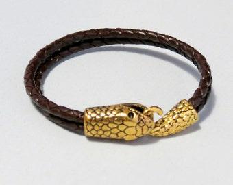 Leather and snake bracelet.