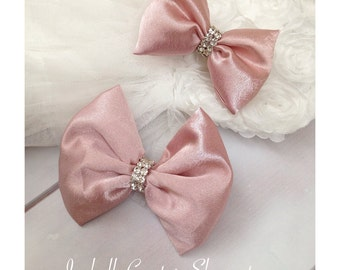 Bow hair clips or headband by Isabella Couture