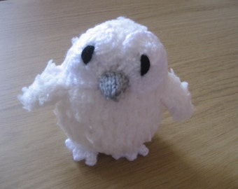 Cuddly soft cream-coloured knitted toy owl