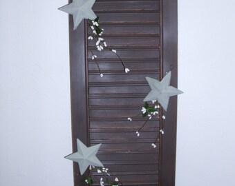 Dark brown antiqued shutters