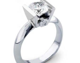 Ladies 14kt white gold modern engagement ring solitaire with 1.50ct Round Brilliant white sapphire and 0.06 carats G-VS2 diamonds