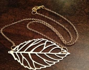 White filigree Eve leaf necklace
