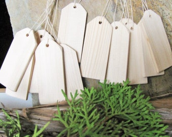 """Twelve wood price/gift tags made in British Columbia, Canada. 1 1/4""""W x 3""""H"""
