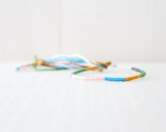 Friendship Bracelet Mustard Turquoise Rose Ivory Grey and Green Embroidery Threads
