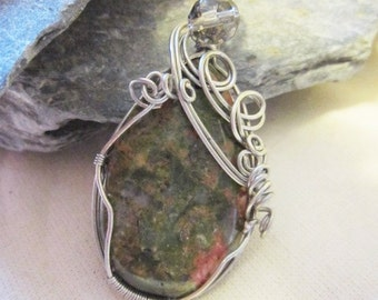 Wire wrapped unakite pendant with woven bail and crystal accents