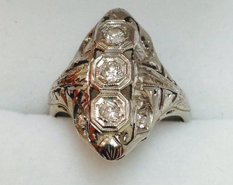An antique diamond platinum  ring