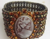 Romantic Bracelet -big cameo and shining dark orange ranstone on sillicon wires.