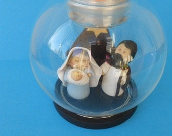 Creche Nativity in cold porcelain in glass/candleholder ball