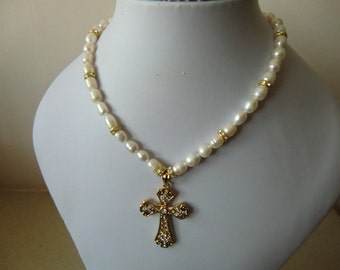 necklace of faux pearls, and a GF gold cross
