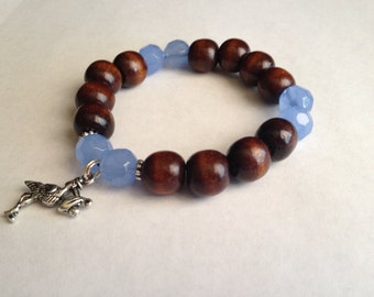 """CLEARANCE *** Splendid wood beads """"baby boy"""" bracelet with blue faceted glass beads and a stork and baby charm"""