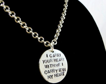 """Sterling silver round Carry Your Heart pendant on a 18"""" long chain"""