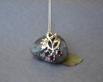 Leaf and flower necklace with red garnet