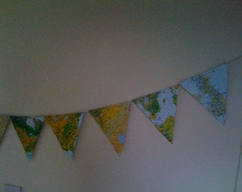 Map Bunting approx 7 ft long with 10 individual flags made in card from prints of maps ideal for travel themed wedding