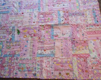 Pink Baby Quilt with yellow ducks on backing