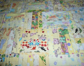 Yellow Baby Quilt with multi colored squares on backside