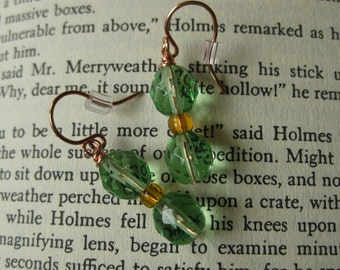 Celadon green and amber glass bead earrings on copper wire