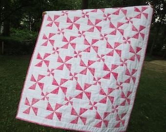 Handmade patchwork baby quilt, raspberry sherbet pinwheels--made to order