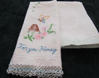 vintage handtowels, one embroidered with tatted edge, one with  pale green edge