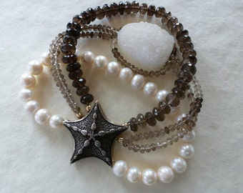 large bronze starfish magnet clasp strands of white pearls faceted smoky quartz and a druzy focal makes Bronze Beauty Bracelet