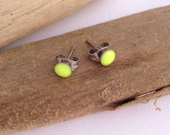 Itty bitty, neon yellow, eco-resin studs on allergy-friendly surgical steel.