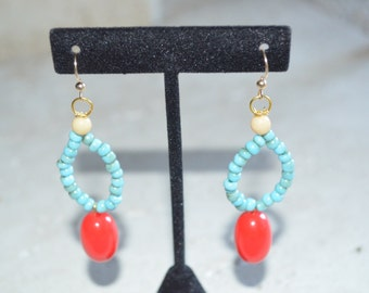 Small blue dangle earrings with tomato red drop pendant