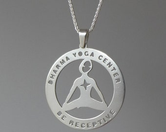 Dharma Yoga Be Receptive sterling silver medallion.