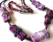 Beaded Fabric Necklace, handmade in purple and lilac. A lovely statement necklace.