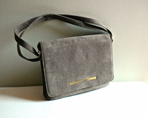 Vintage grey micro suede purse with front flap and adjustable strap. Three compartment purse. grey bag.