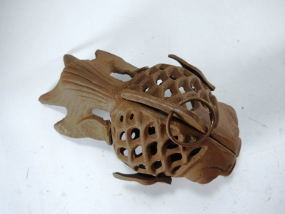 Cast iron fish candle holder from dcmach on etsy studio for Cast iron fish