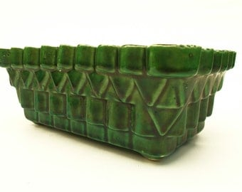 Green planter with Aztec inspired motif
