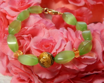 Prosperity And Happiness.Georgio's Peridot Braclet with Tiger Eye Dragon Bead.