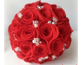 Handmade alternative wedding bouquet of red felt roses with crystal and pearl detailing.