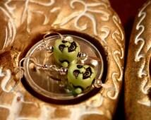 Lime green buddha head earrings