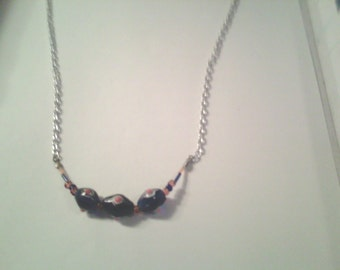 Glass bead and chain necklace.