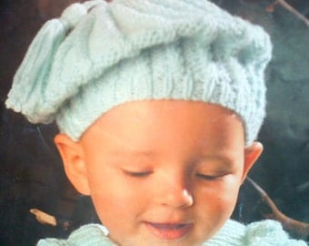 Hand knit babies Aran beret twist stitch design