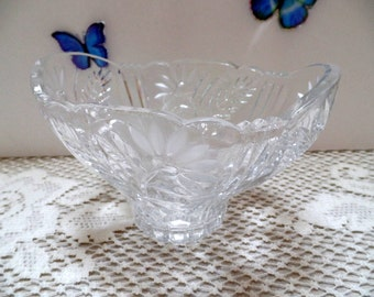 "Beautiful Cut glass bowl with frosted florals.  This oblong bowl has a decorative, scalloped edge, and is 3 3/4"" tall"