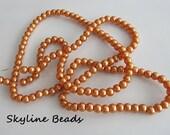 "Glass Pearl Beads, Pearlized Orange, 6mm Round 32"" strand"