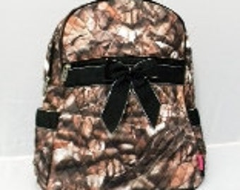Machine embroidered Quilted Back-pack.  Personalized to your needs.  Real Tree Camo Pattern with Black, Brown, Orange or Pink Trim.