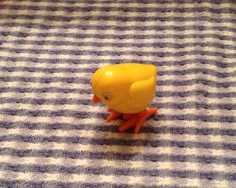 Lot of three Tomy wind up toys