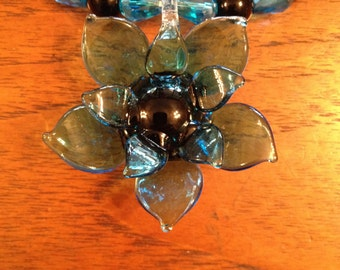 Blue Lampworked Glass Flower Pendant on Glass Necklace