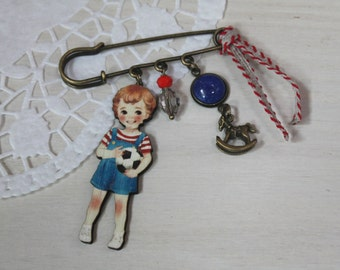 boy in balloon brooch