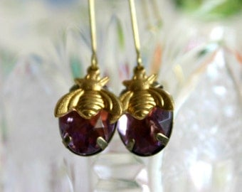 Plated earrings with Amethyst coloured crystal and brass little bee