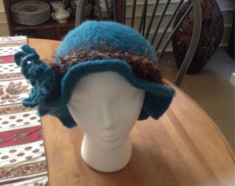 Felted Turquoise brim hat with crochet flower brown and turquoise fur band.